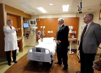 Dr. David Herndon, left, chief of staff for the UTMB burn service, talks about the renovations to the patient rooms in the Blocker Burn Unit during the rededication ceremony.