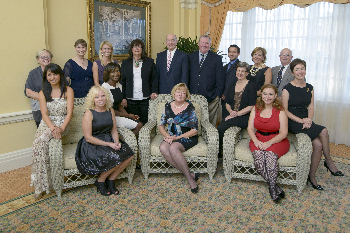 The 2013 award winners are, seated from left, Roxanne Radi, medical student; Rebecca L. Trout, executive director for community relations; Dr. Tuere Coulter, assistant professor, family medicine; Nancy Schultz, executive director of the Galveston Children's Museum; Dr. Juliet McKee, assistant professor, family medicine; Julie Kutac, doctoral candidate, Institute for Medical Humanities; and Gisele A. Lombard, senior lung transplant coordinator.  Standing, from left, Dr. Cheryl S. Watson, professor, department of biochemistry and molecular biology; Dr. Vicki Freeman, President's Cabinet awards committee chair; Dr. Meredith Masel, program manager, Oliver Center; Ellen Adriance, applications system analyst; UTMB President, Dr. David L. Callender; Dr. William Mileski, chief, trauma surgery; David Gersztenkorn, medical student; Ann Masel, President's Cabinet chair; and Dr. John Fraser, professor, department of preventive medicine and community health.