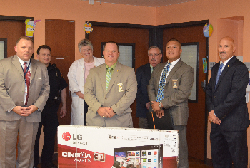 GPD Chief Henry Porretto, Drs. John Kelley and Joan Richardson, and UTMB Police Chief Thomas Engells meet in the UTMB Children's Hospital where members of the GPD presented a flat-screen television for the pediatric patients.