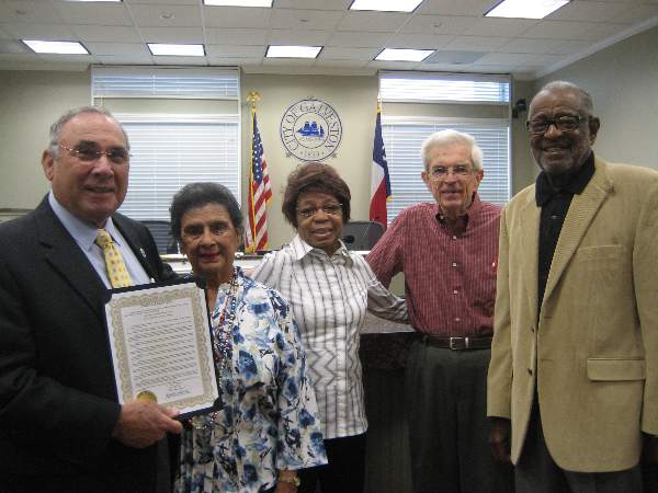 Galveston Mayor Lewis Rosen recognizes senior volunteers Amelia Collins, Bettie Wheeler, Wayne O'Quin and Richard Batie.