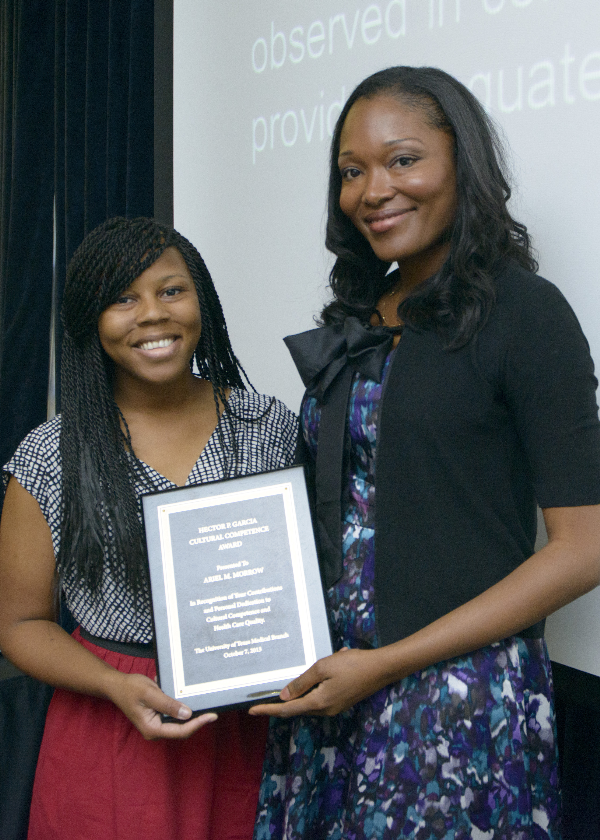 Award winner, Ariel M. Morrow and Adeola Oduwole, director of UTMB Diversity & Inclusion.