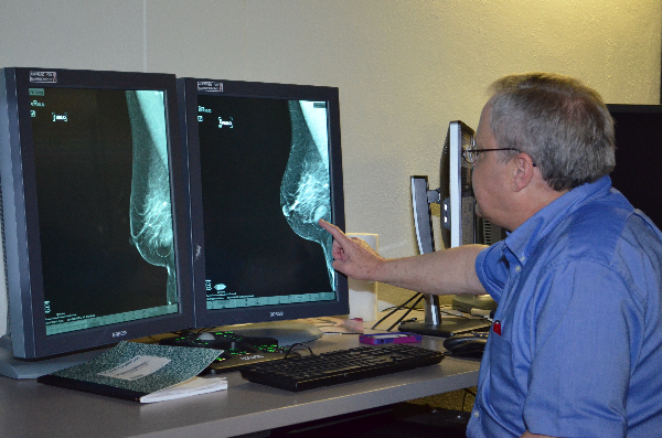 UTMB Director of Breast Imaging Dr. Morton Leonard points to a suspicious mass in a breast mammogram image. .