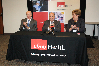 Dr. David L. Callender, David Marshall and Donna Sollenberger celebrate UTMB Magnate recognition.