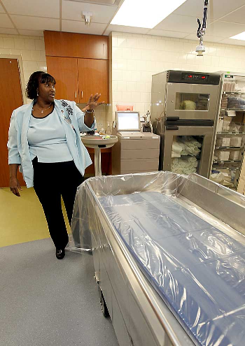 Debbie Marshall, a registered nurse, shows off the new hydrotherapy treatment room in the Blocker Burn Unit at UTMB.