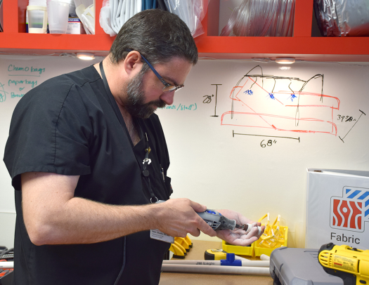 Jason Sheaffer works on a prototype of one of his ideas to improve nurse efficiency and patient care in the MakerHealth Space lab.