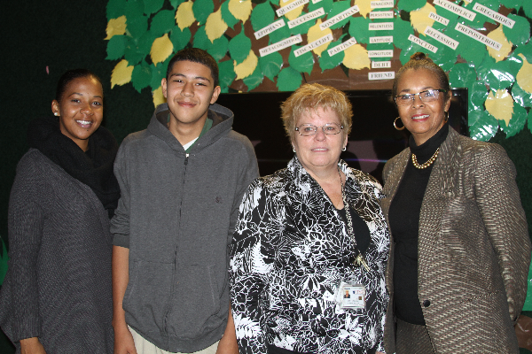 A phone call from 12 year-old Miguel Gonzales, pictured with his teacher Ashley Williams, UTMB's Joan Nichols and principal Patricia Williams, resulted in a new collaboration between the Galveston National Lab and Ambassadors Preparatory Academy.