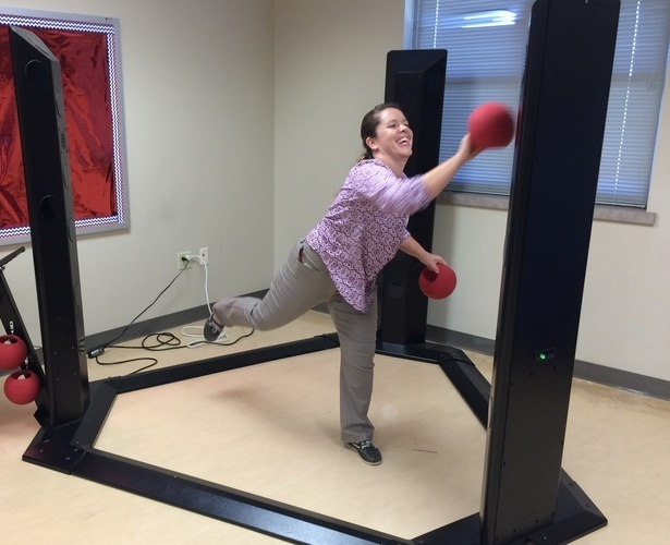 Fifth year master's degree occupational therapy student Brittany Jenkins stands on one leg and throws a ball