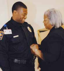 New UTMB Police Department Sergeant Ronnie Johnson, left, is pinned at his promotion ceremony by his mother, Margaret Johnson.