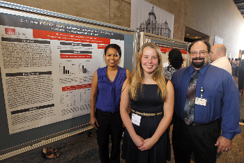 Jazmin Ruiz, KarryAnne Belanger and Dr. Bill Ameredes attend the GSBS poster presentation.