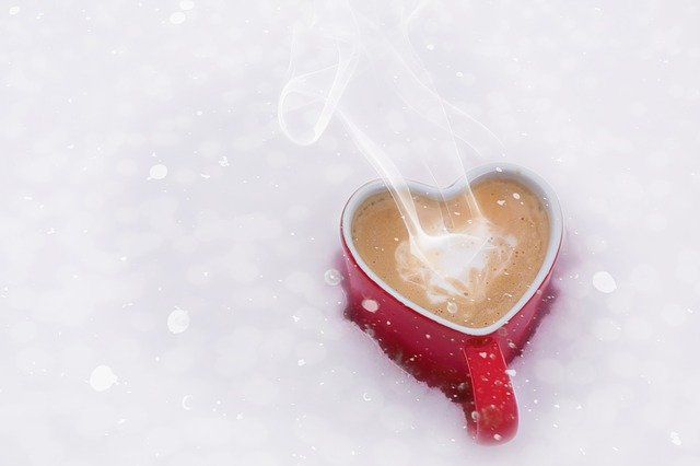 coffee cup steaming in snow
