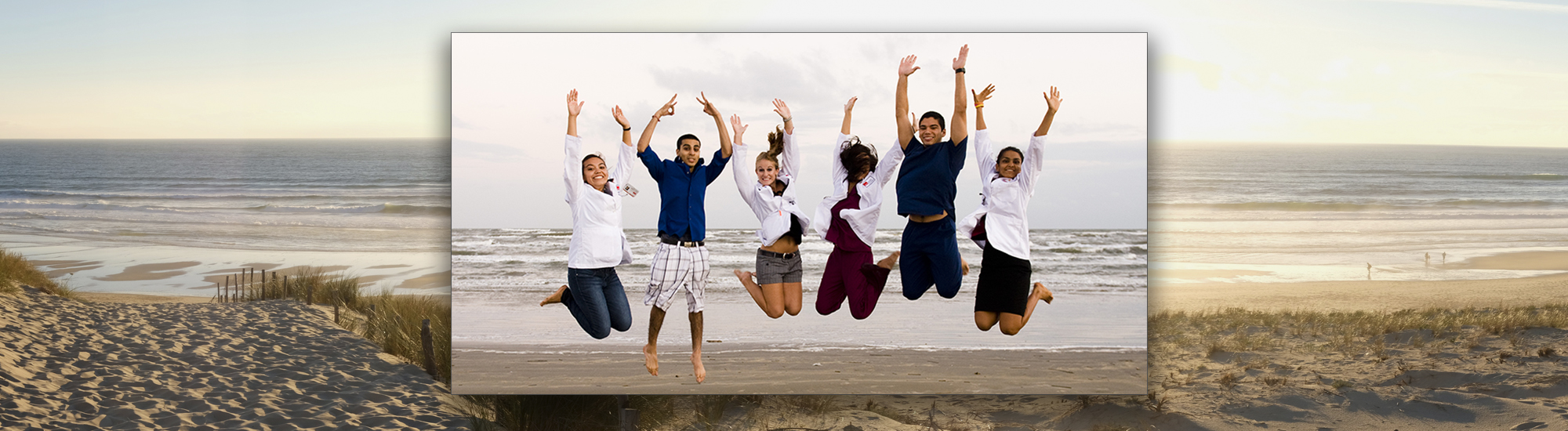Beach Students jumping for joy