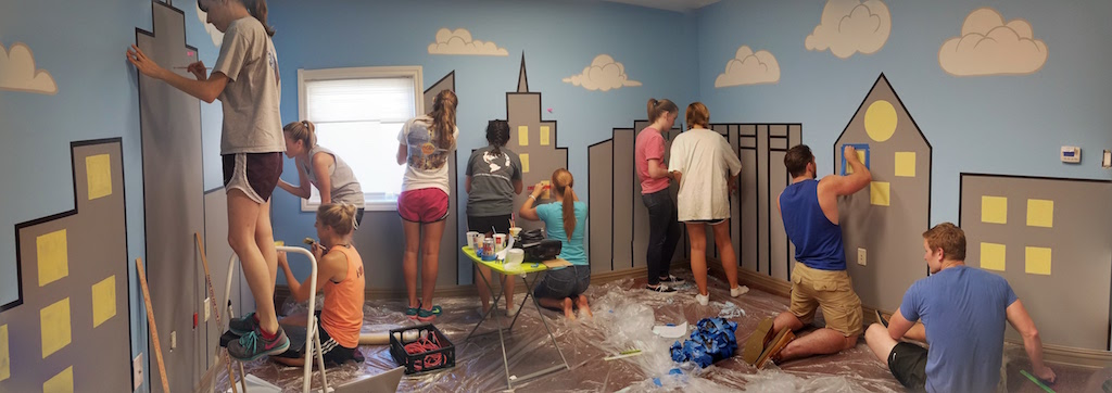 PA Class of 2017 painting a city scene.