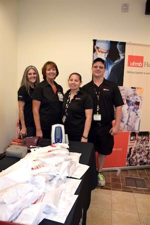 Visor (left) with ADC colleagues Cheryl Vining, Irene Vidana and Michael Washburn at a health fair in Pearland.