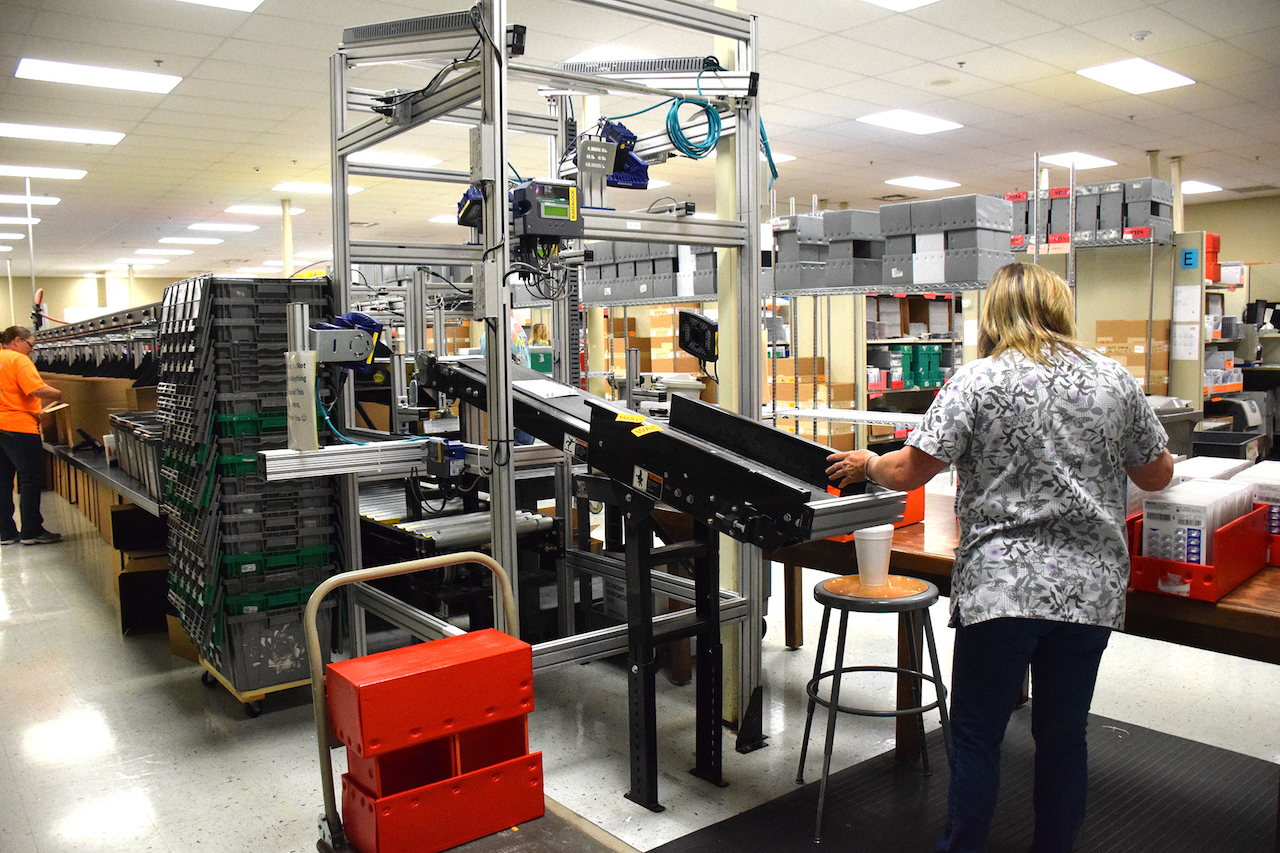 State-of-the-art automated devices sort medications at high speed at UTMB CMC's central pharmacy in Huntsville.