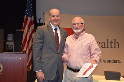Dr. Randall Goldblum received special recognition from UTMB President David Callender for his 45 years of service.
