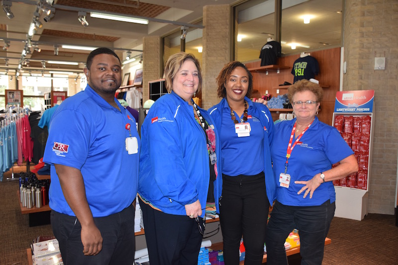 Moore with members of the UTMB Campus Store team: (L-R) Corey Bougere, Leslie Borsellino, Moore and Sandra Low