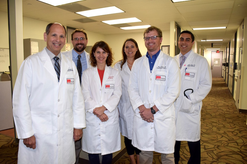 Dr. Randall Urban (left) with members of the Daniels Team, Drs. Matthew Mrazek, Megan Berman, Lindsay Sonstein, Brian Harris and Carlos Clark.