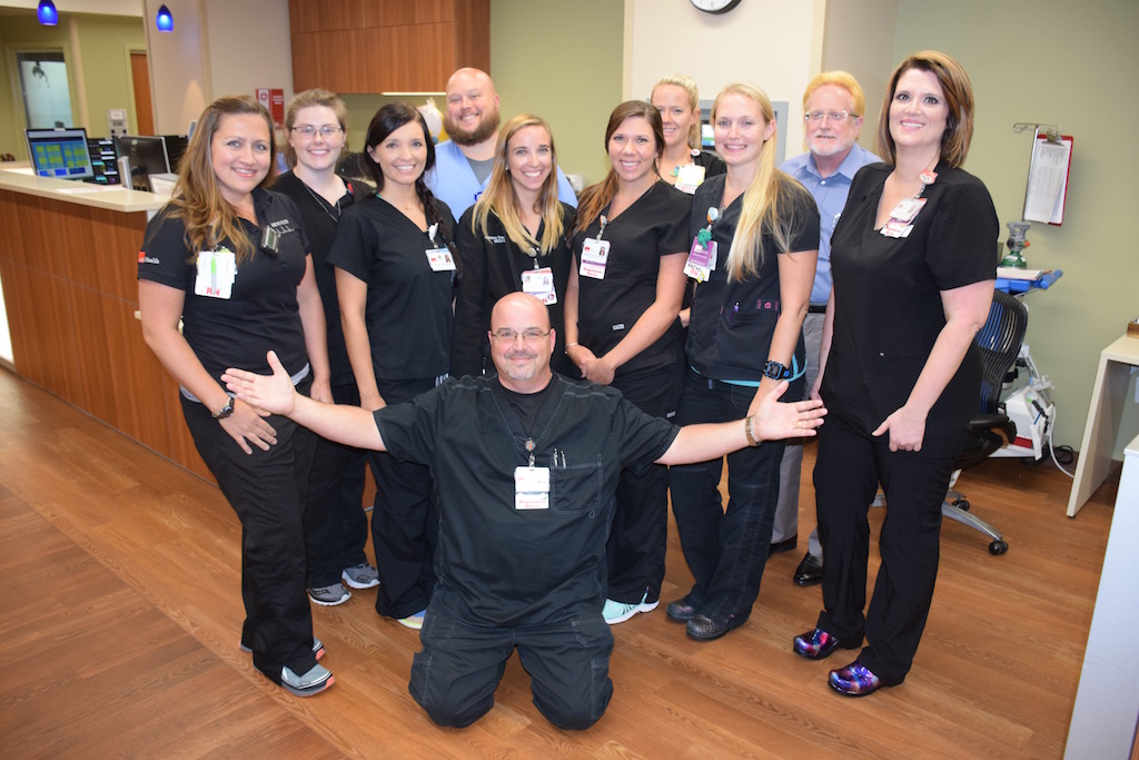 Nurse manager Robert Hastedt (center) and the MICU nursing team
