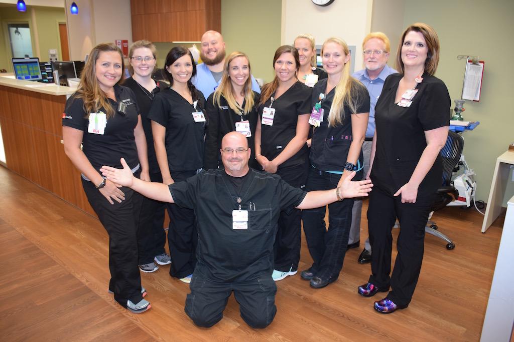 Nurse manager Robert Hastedt (center) and the MICU nursing team