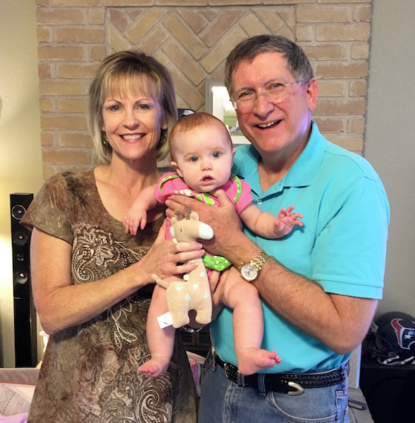Garwood and his wife with their grandchild, Claire.