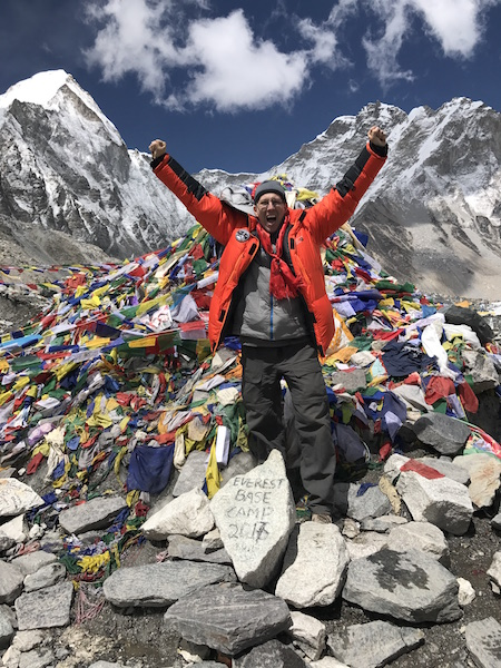 Dr. Harold Pine stands at Everest Base Camp, an elevation of about 17,500 feet