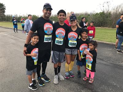 Marlon Sukal, director of talent and organizational development at UTMB, and his family took part in the 5k and 1k events.