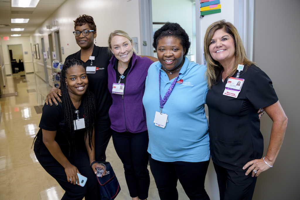 Norris with staff from the Women's Health clinic