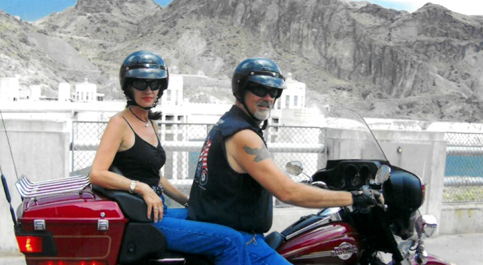 Marcel Blanchard and his wife, Debbie, ride a motorcycle across the Hoover Dam.