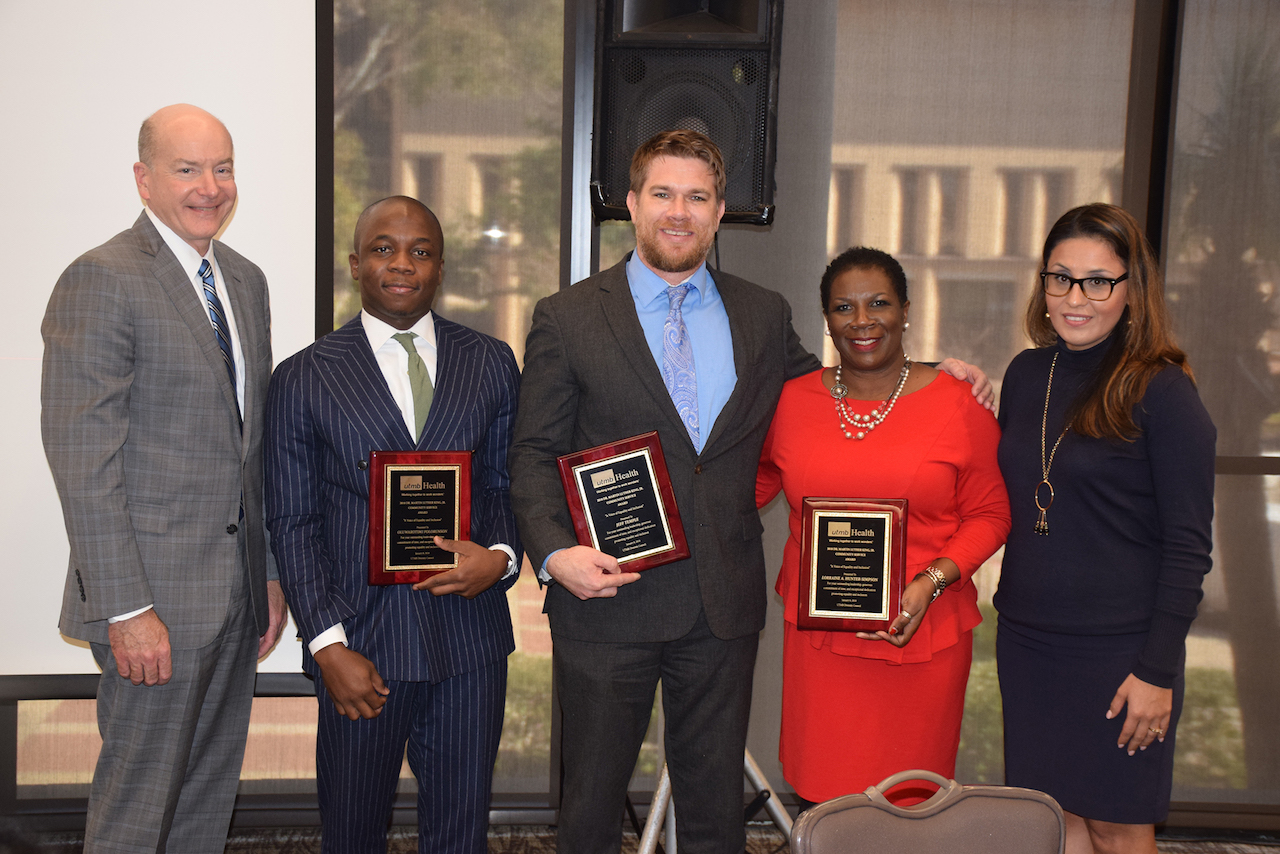 Dr. David Callender and Imelda Wicks stand with the winners of the annual Dr. Martin Luther King Jr. Community Service Awards. Recipients rom left to right: Dr. Oluwarotimi Dolorunso, Dr. Jeff Temple and Lorraine Hunter-Simpson.