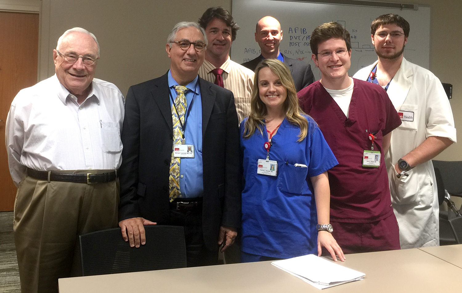 UTMB's coagulation DMT includes (L-R): Drs. Jack Alperin, Michael Laposata, Aristides Koutrouvelis, Camila Simoes, Chad Botz, Aaron Wyble and Jacob Wooldridge.