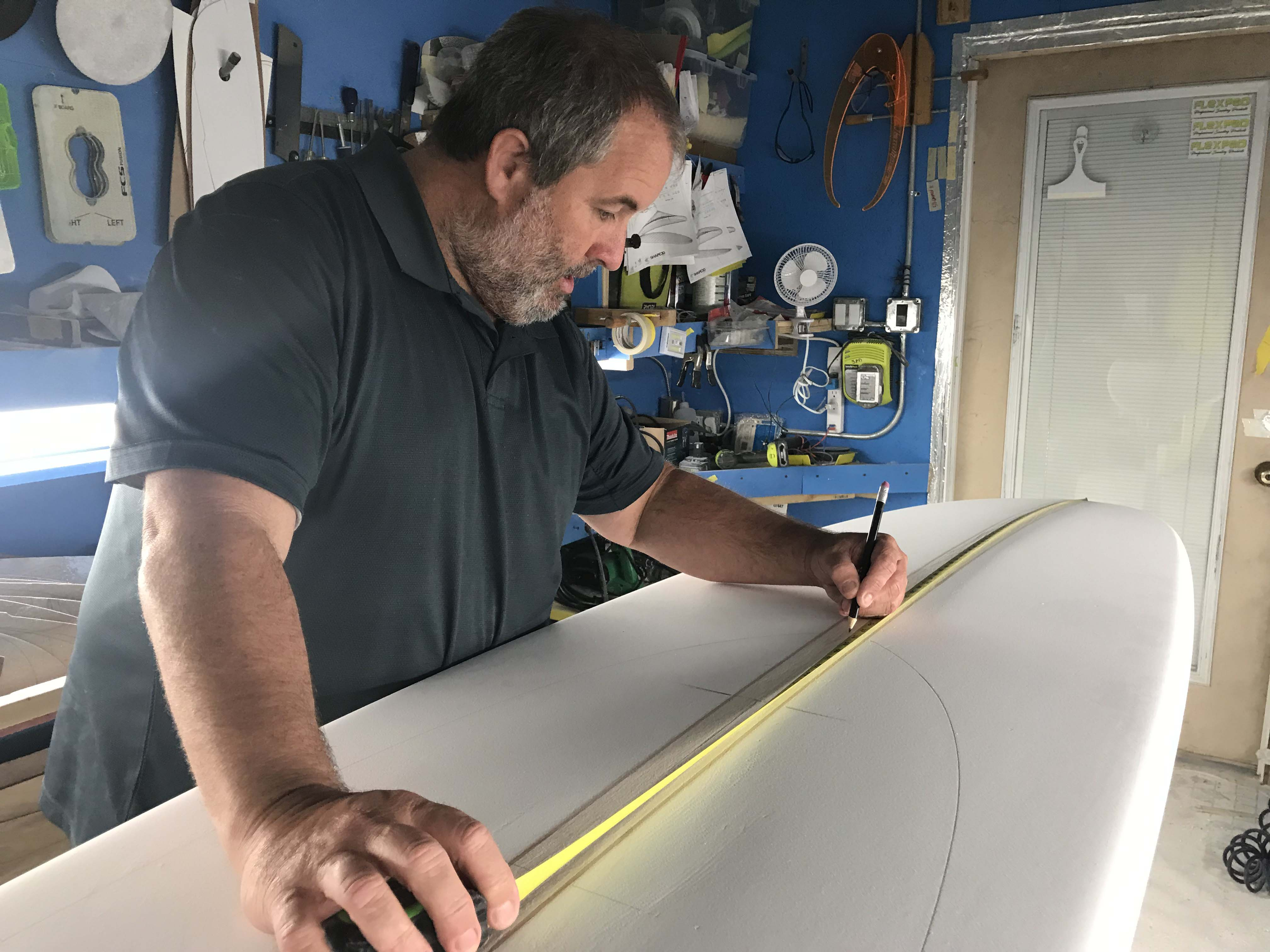 Stephen Pearson Shaping a surfboard