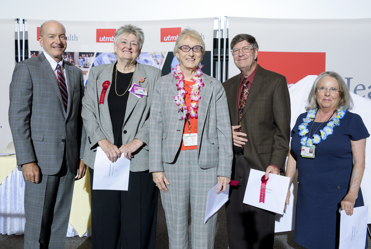 Dr. Callender (left) with 45-year employees Dr. Joan Richardson, Dr. Barbara Thompson, Johnny Peterson, PhD, and Shirley McGraw.