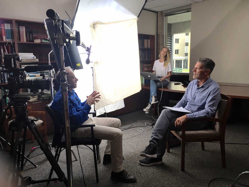 Rakez Kayed, PhD, (left) does an interview with journalist Stone Phillips about cutting-edge neurodegenerative research being done at UTMB.