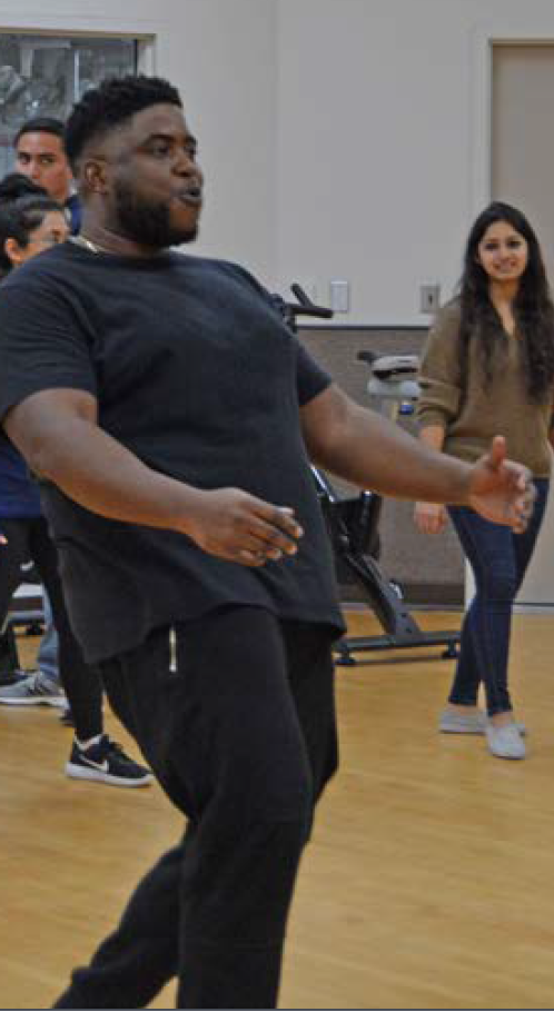 Image of Dr. Ford Ben-Okoli leading a dance class on campus