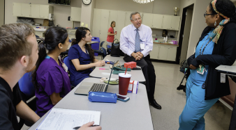 utmb's new dean of school of health professions dr. david a. brown with students