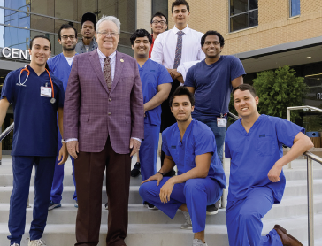 image of Dr. Raimer with students at HEC