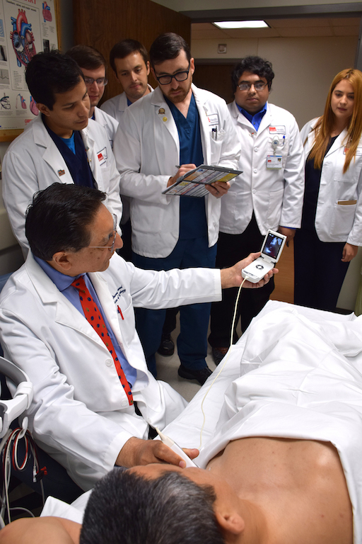 Dr. Masood Ahmad shows medical students how to use a portable ultrasound device to get images of the heart while at the patient's bedside.