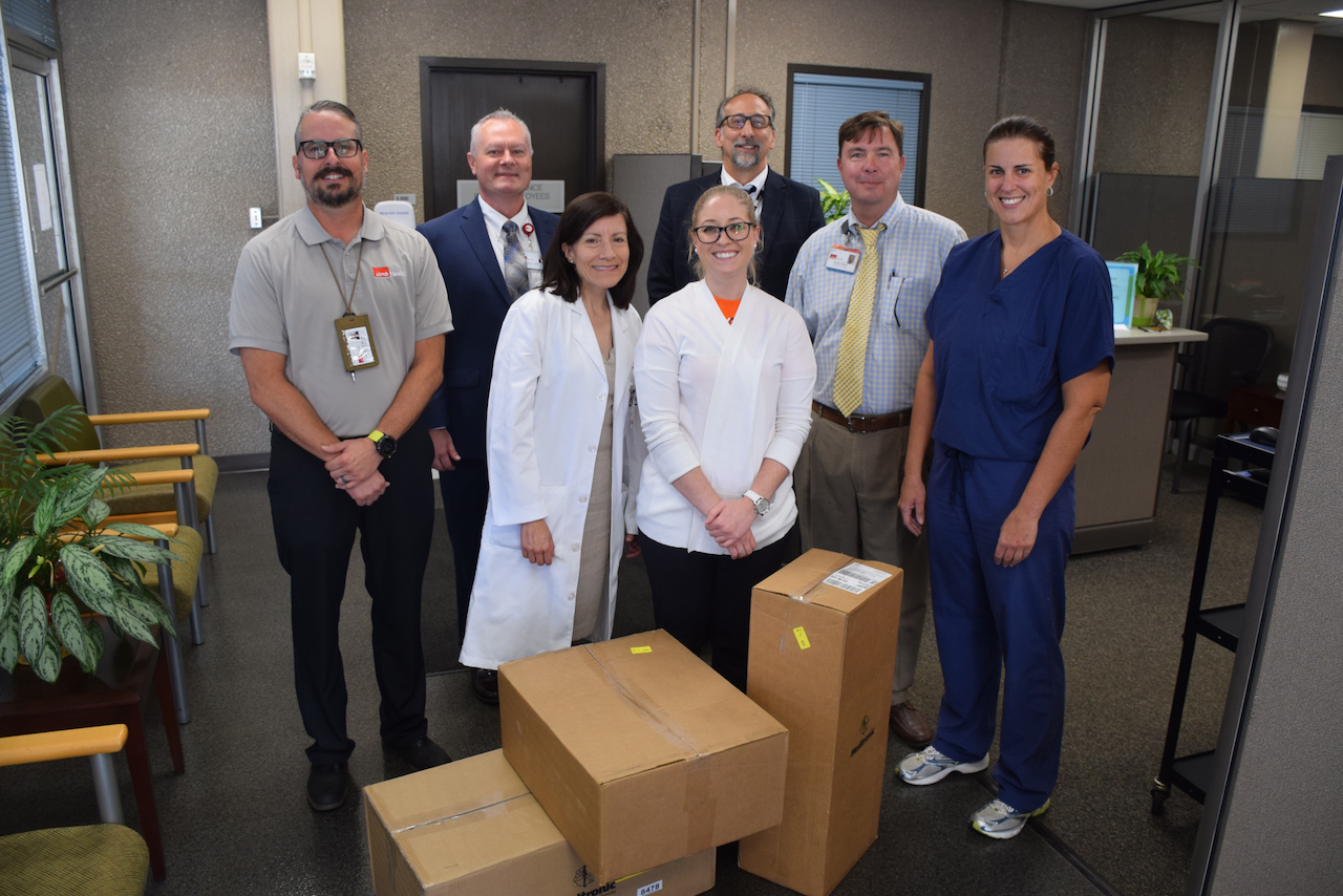 Supply Chain Logistics team members, Dr. Maria Belalcazar and Dr. Patricia Maeso stand with UTMB's $10,000 medical supply donation.