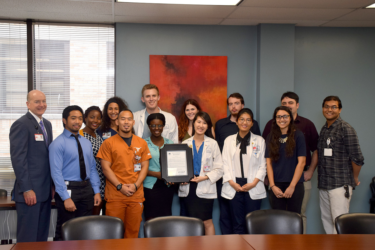 Dr. David Callender stands with members of UTMB's Student Government Association