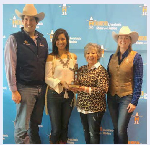Ashley Shriver and Alma Block with UTMB School of Medicine's Educational Affairs Department  win first-place honors in the Houston Livestock Show and Rodeo's Go Texan Day contest.