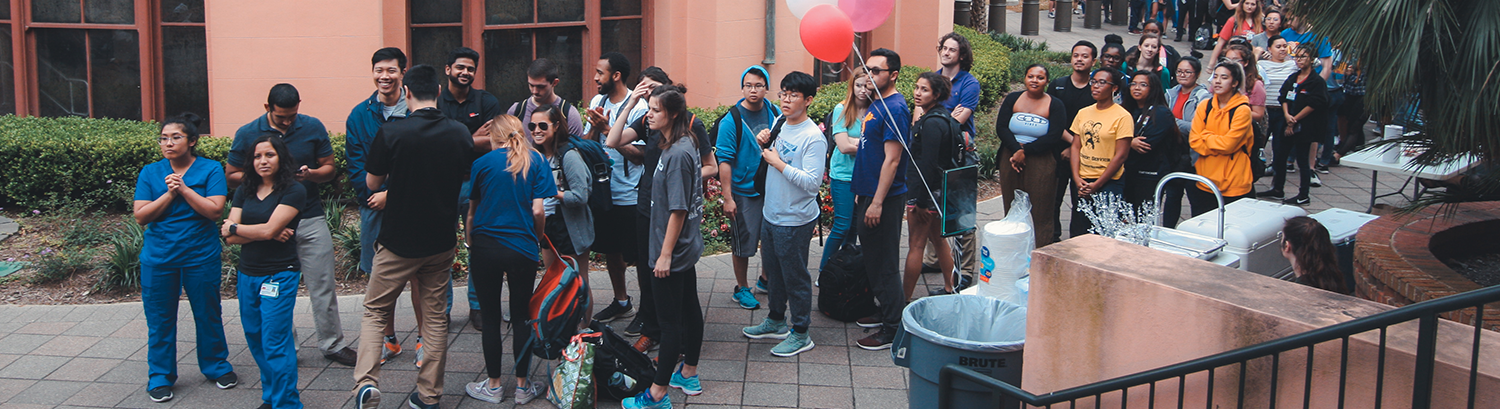 Students line up for crawfish at a student organization event.
