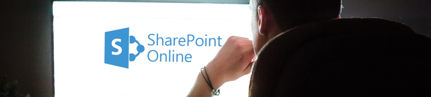 Man looking into large white monitor with SharePoint logo