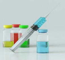 photo of syringe and coltainers ofcolored liquid