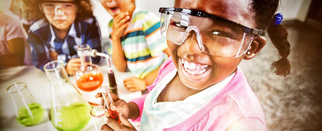 Joyful little girl learing science