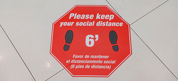 Social distance floor signs mark 6 foot social distance