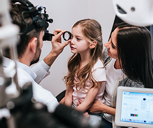 Girl getting eyes examined