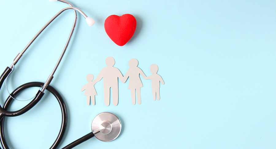stethoscope, paper cutout of a family and a heart