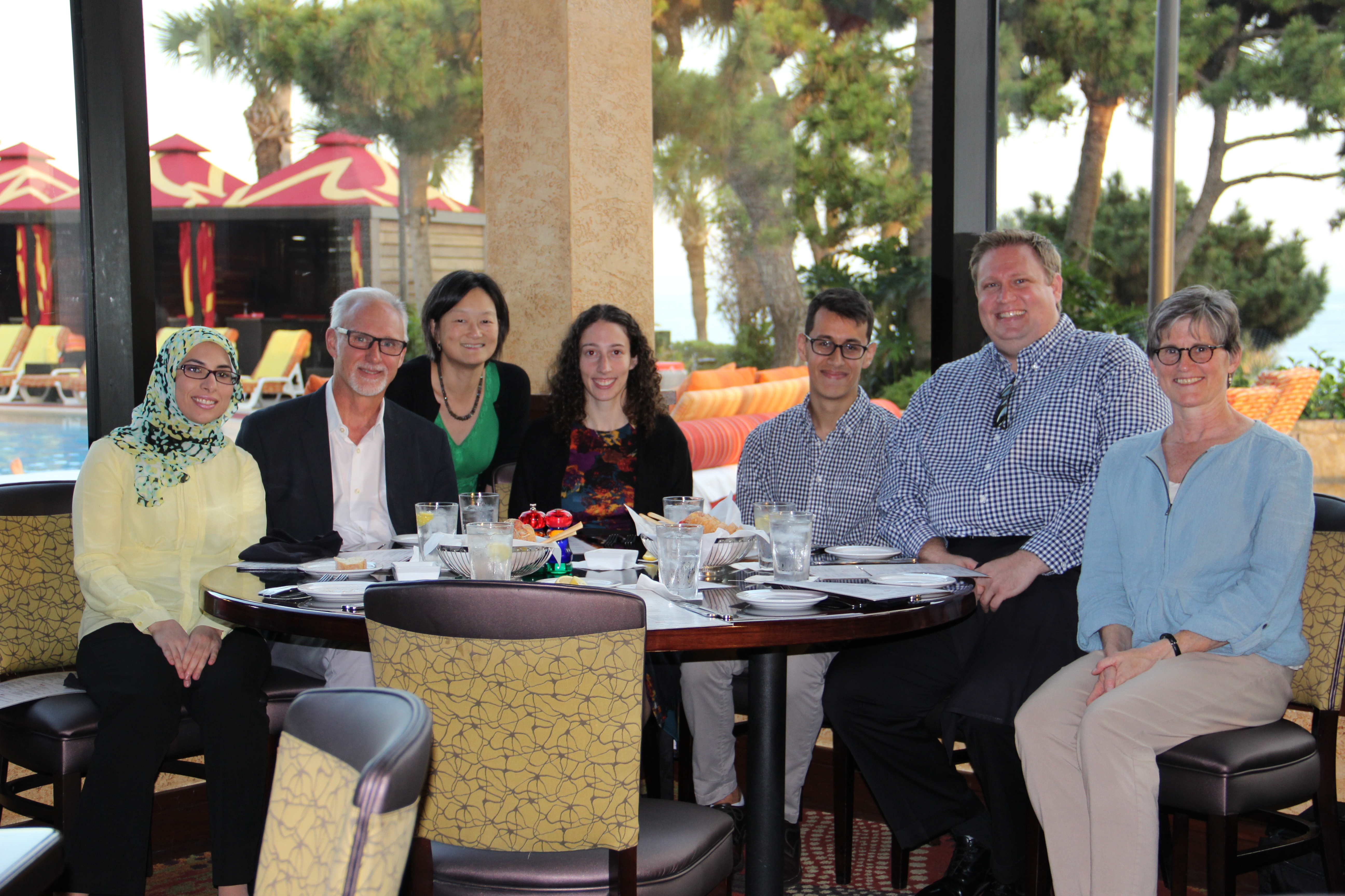 HPTM faculty and students attend the annual holiday gathering. (L to R) - Dr. Huda Sarraj, Dr. Mark Hellmich, Dr. Celia Chao, Corri Levine, Austin Miller, Edward Higgins, Dr. Judith Aronson