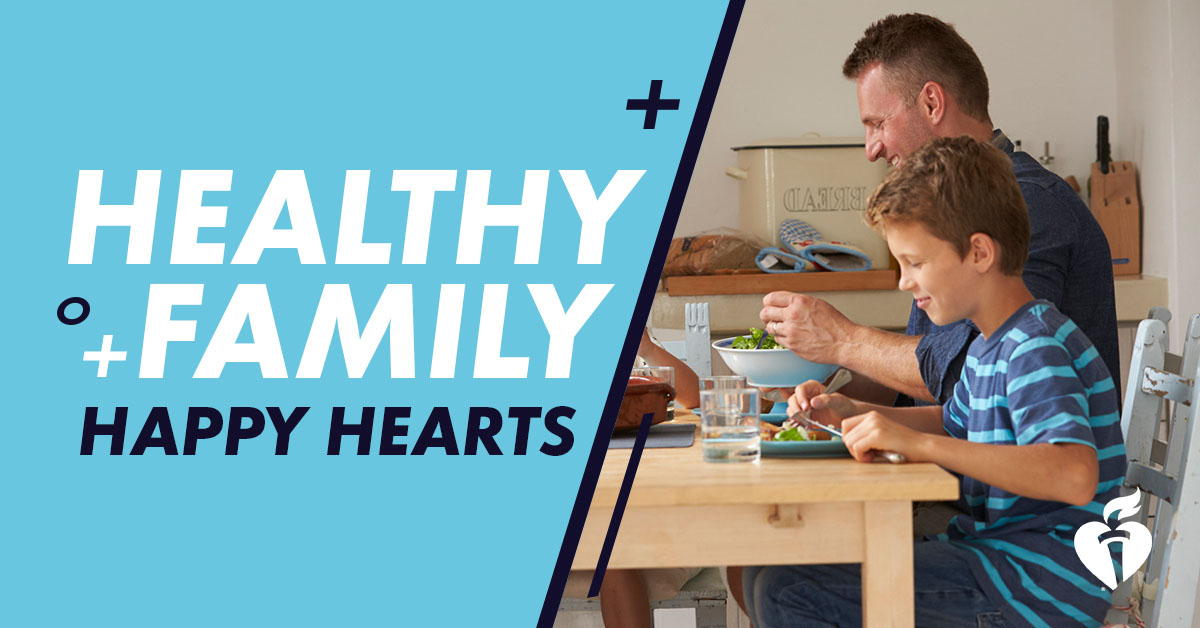 healthy family, happy hearts - dad and son eating a meal together